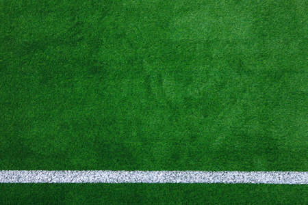 Photo of a green synthetic grass sports field with white line shot from above  photo