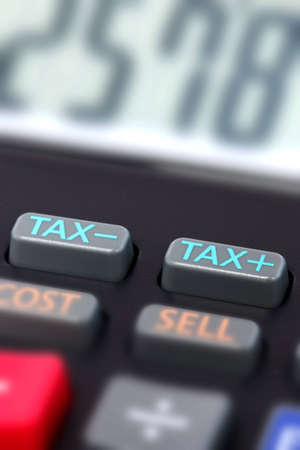 taxable: Close up of the tax buttons on a calculator