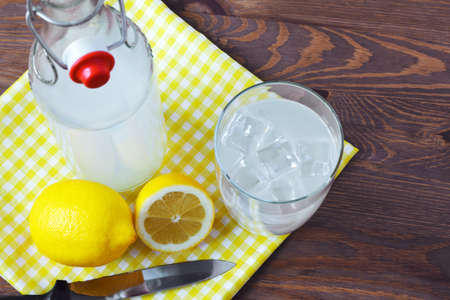 Still life photo of old fashioned or traditional homemade sour lemonade from an old style glass bottle. photo