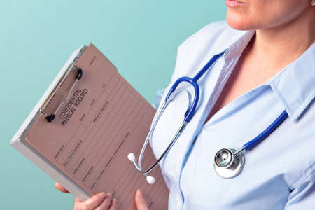 clinical staff: Photo of a female doctor holding a medical record Stock Photo