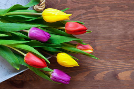 Fresh tulips flowers on a rustic wooden table Stock Photo - 13203178