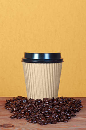 Photo of a takeway paper disposable cup with coffee beans and copy space to add you own message. Stock Photo - 13248060