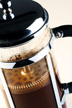 with coffee maker: Photo of a Cafetiere with freshly brewed coffee inside, this is also known as a French press Stock Photo