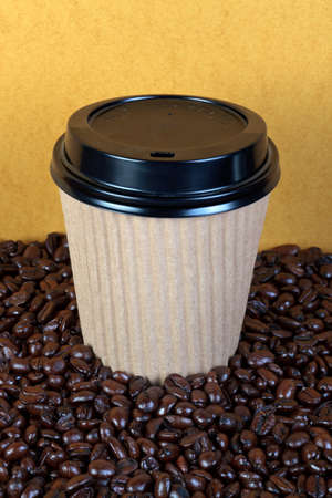 Photo of a takeaway paper coffee cup with lid on a mixture of arabica and robusta beans. Stock Photo - 13508362