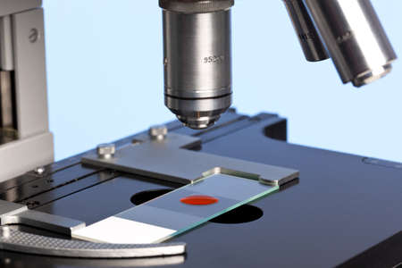 Photo of a laboratory microscope with a blood sample on a glass slide. Stock Photo - 13508340