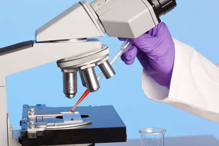 Photo of a laboratory microscope with a blood sample on a glass slide. Stock Photo - 13508341