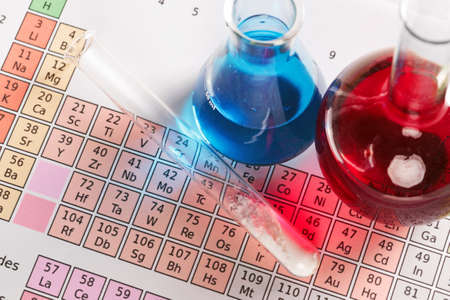 Photo of a pedic table of the elements with flasks and test tube containing chemicals both liquid and powder. Stock Photo - 13508370