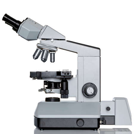 eyepiece: Photo of a professional ocular laboratory microscope with stereo eyepiece isolated on a white background. This is a genuine piece of equipment and the type that would be used in a real lab.