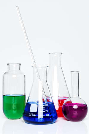 Photo of chemistry flasks full of chemicals on a plain background  Stock Photo - 14240576
