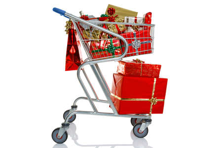 trolley: A shopping trolley full of gift wrapped Christmas presents, isolated on a white background  Stock Photo
