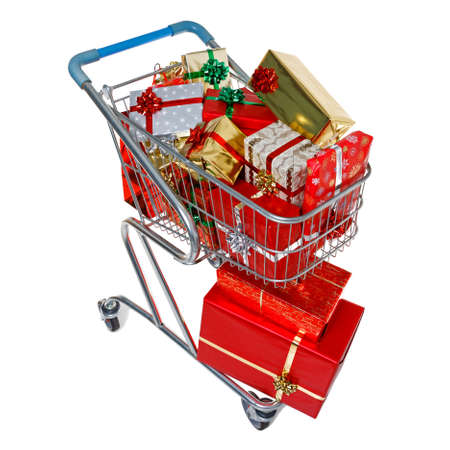 A shopping trolley full of gift wrapped Christmas presents, isolated on a white background  Standard-Bild