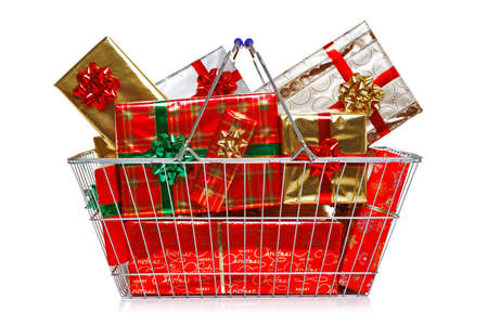 A wire shopping basket full of gift wrapped Christmas presents isolated on a white background  Stock Photo - 15228578