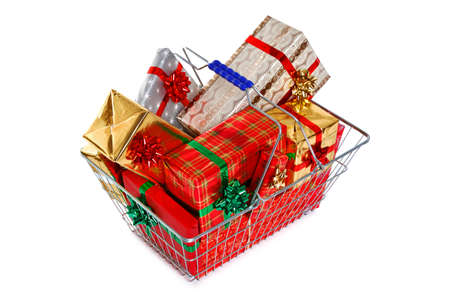 A wire shopping basket full of gift wrapped Christmas presents isolated on a white background  Stock Photo - 15235933