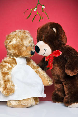 Two bears kissing under the mistletoe.The Teddys are generic and are not brand name bears. Stock Photo - 15512423