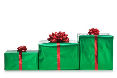 Three gift wrapped presents in green wrapping paper with red bow and ribbon, isolated on a white background. photo