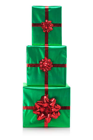 Three gift wrapped presents in green wrapping paper with red bow and ribbon, isolated on a white background. Stock Photo - 15860546