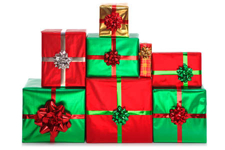 A group of gift wrapped presents in bright shiny wrapping paper with bows and ribbons, isolated on a white background.  Stock Photo - 15860548