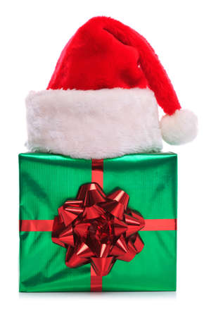 Photo of a Santa Claus hat on a green gift wrapped present with large red bow and ribbon, isolated on a white background. Stock Photo - 15860549