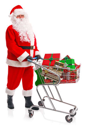 Santa Claus doing his Christmas shopping with a trolley full of gift wrapped presents, isolated on a white background. Stock Photo - 15860556