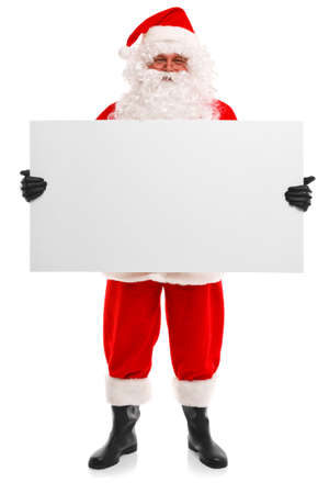 Santa Claus holding a blank sign, isolated on a white background with copy space to add your own message.
