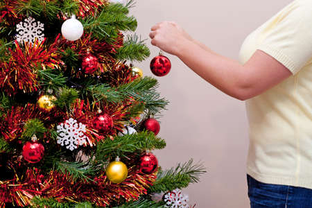 Photo of a woman decorating her Christmas tree Stock Photo - 15860554