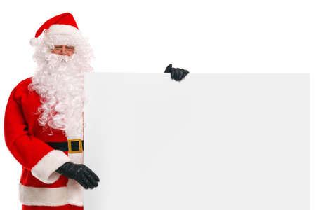 weihnachtsmann: Photo of Santa Claus holding a large blank sign, copy space to add your own Christmas message. Stock Photo