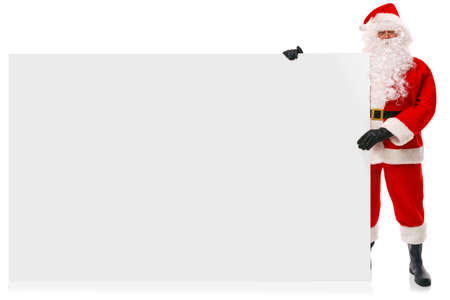 Full length photo of Santa Claus holding a large blank sign for you to add your own Christmas message, isolated on a white background.