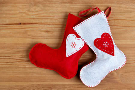 Handmade Christmas stockings on a wooden background with copy space. Stock Photo - 16379870