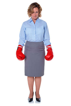 blouse: Photo of a businesswoman wearing boxing gloves, isolated on a white background.