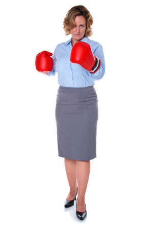 retaliation: Photo of a businesswoman wearing boxing gloves, isolated on a white background.