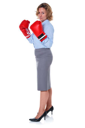 Photo of a businesswoman wearing boxing gloves, isolated on a white background. Stock Photo - 16301990