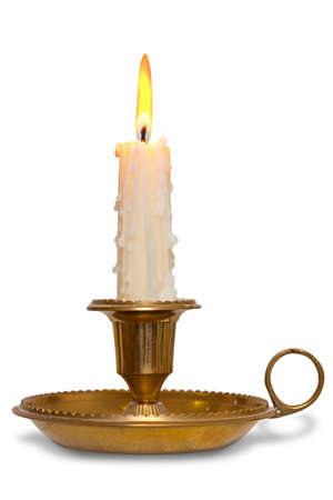 candlestick: A dripping wax candle burning with flame in a traditional brass holder known as a chamberstick, isolated on a white background.