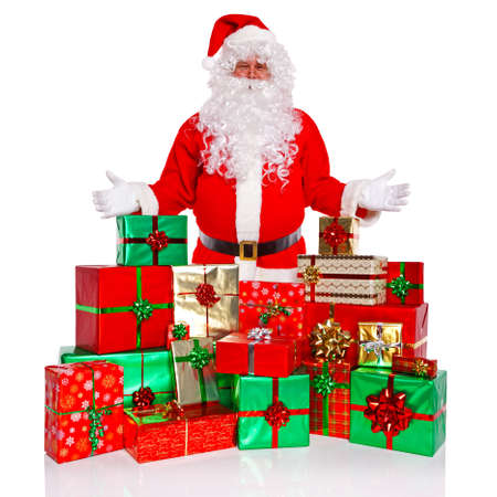 Santa Claus or Father Christmas standing with a large collection of gift wrapped presents, isolated on a white background. Standard-Bild