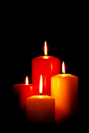 Four red and white Christmas candles on a black background. Stock Photo - 16663270