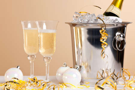 Two Champagne flutes and a bottle in an ice bucket Stock Photo - 16930922