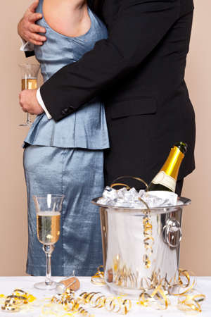 A couple embracing with glasses of Champagne at a party, good image for New Years Eve, Wedding or Anniversary themes. Stock Photo - 16734466