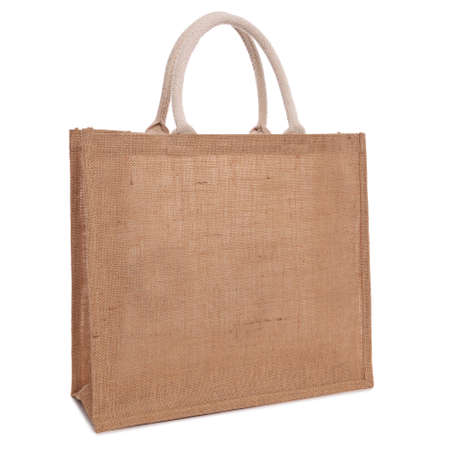 handle: A recycled hessian or jute shopping bag isolated on white background. Stock Photo
