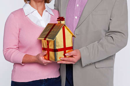 Concept image of a couple with their new home. Stock Photo - 16970742