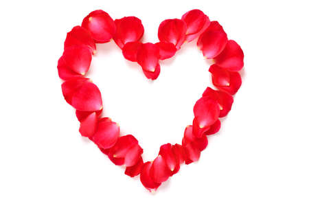 Red rose petals arranged into a heart shape with copy space in the middle, isolated on a white background with slight shadow.