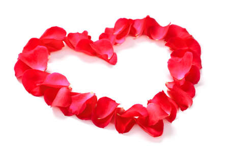 Red rose petals arranged into a heart shape with copy space in the middle, isolated on a white background with slight shadow. Stock Photo - 17007176