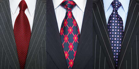 mens: Triptych photo of a three pinstripe suits with shirt and ties. Stock Photo