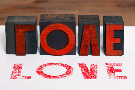 The word LOVE printed on white paper with old wooden letterpress blocks. Stock Photo - 17226328