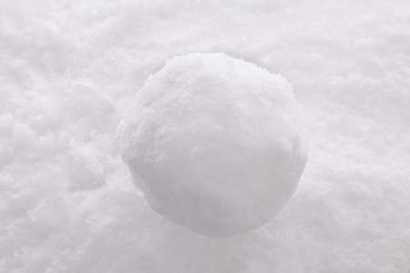 snowballs: One single snowball on a snow background. Stock Photo