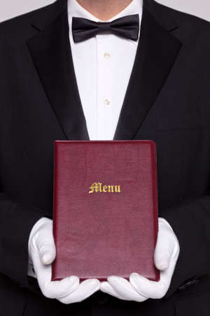 Waiter holding a Menu folder in a restaurant. photo