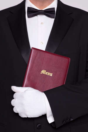 Waiter holding a Menu folder in a restaurant. Stock Photo - 17727201
