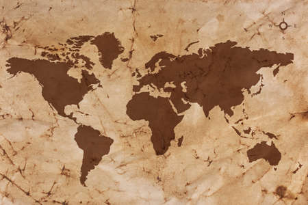 vintage world map: Old World map on creased and stained sepia coloured parchment paper.
