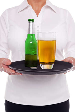 Waitress holding a tray with a glass and bottle of beer on it, white background. Stock Photo - 17833915