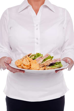 Waitress serving you a plate of sandwiches and snacks, white background. Stock Photo - 17833938