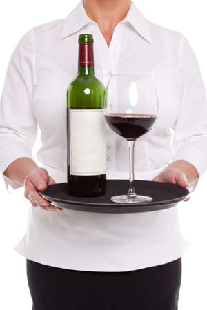 Waitress holding a tray with a bottle and glass of red wine, blank label should you wish to add your own text. Stock Photo - 17833910