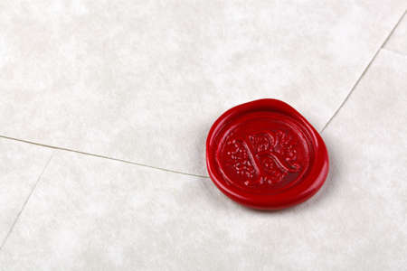 wax seal: Envelope made from parchment paper sealed with a red wax seal
